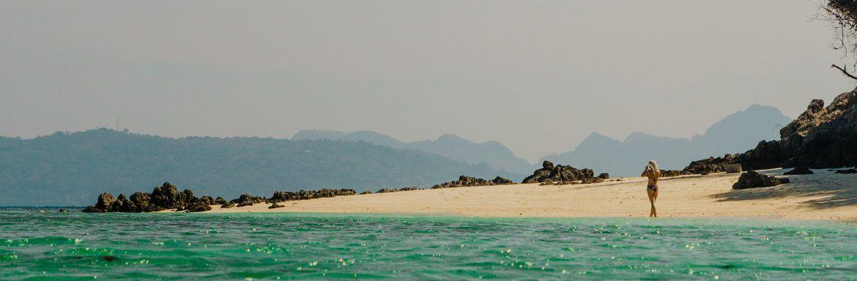Waarom je op een tropisch strand kunt liggen, maar tóch ongelukkig kunt zijn